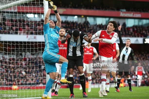 Arsenal goalkeeper Bernd Leno collides with Jamaal Lascelles of Newcastle as he jumps up to punch the ball clear during the Premier League match...