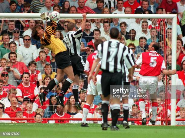 Arsenal goalkeeper David Seaman clashes with Alan Shearer as he saves the ball from a Newcastle attack during today's FA Carling Premiership match...
