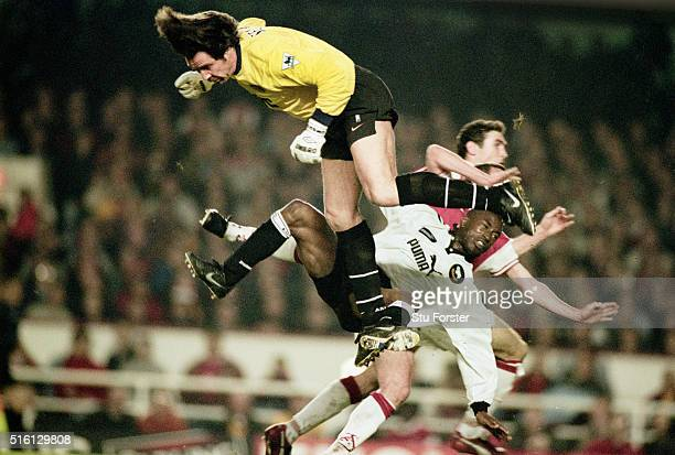 Arsenal goalkeeper David Seaman collides with Derby County striker Paulo Wanchope during a FA Premiership match at Highbury on April 29 1998 in...