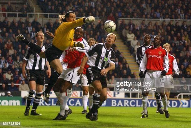 Arsenal goalkeeper David Seaman punches the ball clear of Newcastle United's Alan Shearer