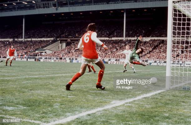 Arsenal goalkeeper Geoff Barnett dives in vain as Leeds United's winning goal flies into the net watched by teammate Peter Simpson and Leeds United's...