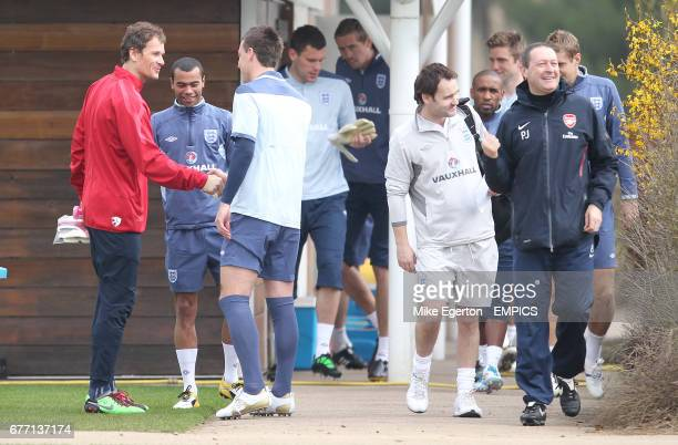 Arsenal goalkeeper Jens Lehmann chat's with England's Ashley Cole and John Terry