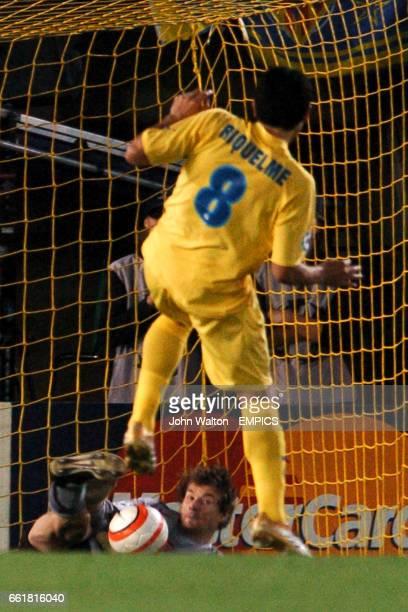 Arsenal goalkeeper Jens Lehmann saves a penalty from Villarreal's Juan Roman Riquelme