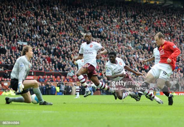 Arsenal goalkeeper Jens Lehmann saves a shot from Wayne Rooney