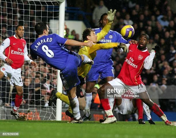 Arsenal goalkeeper Jens Lehmann saves from Chelsea's Frank Lampard