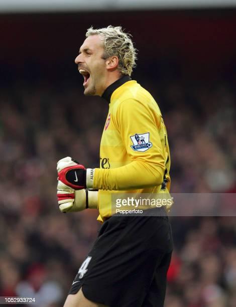 Arsenal goalkeeper Manuel Almunia celebrates after saving a penalty by Dimitar Berbatov Tottenham Hotspur during the Barclays Premier League match...