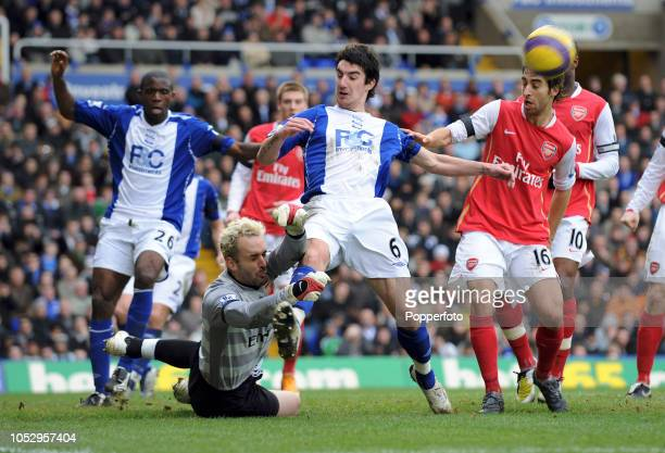 Arsenal goalkeeper Manuel Almunia saves from Liam Ridgewell of Birmingham during the Barclays Premier League match between Birmingham City and...