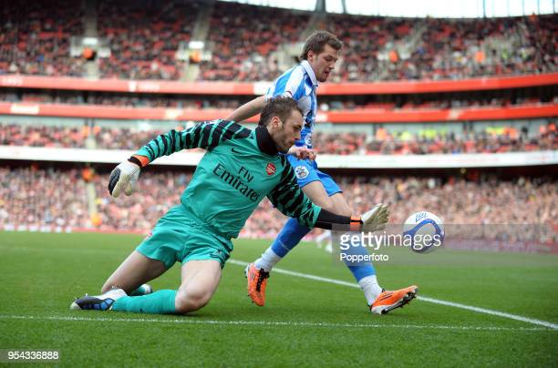 Arsenal goalkeeper Manuel Almunia saving from Anthony Pilkington of Huddersfield during the FA Cup sponsored by EON 4th round match between Arsenal...