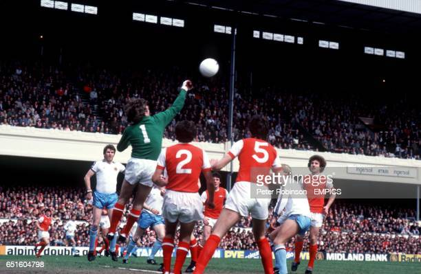 Arsenal goalkeeper Pat Jennings punches clear at a corner