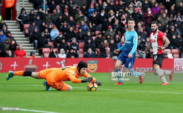 Arsenal goalkeeper Petr Cech saves from Charlie Austin during the Premier League match between Southampton and Arsenal at St Mary's Stadium on...