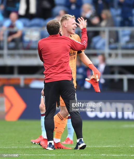 Arsenal goalkeeping coach Inaki Cana Pavin hugs Aaron Ramsdale after the Premier League match between Burnley and Arsenal at Turf Moor on September...