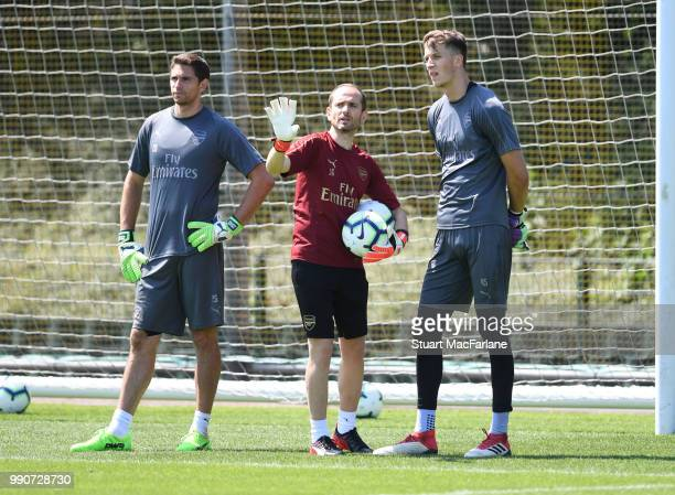 Arsenal goalkeeping coach Javi Garcia talks with Emiliano Martinez and Matt Macey during a training session at London Colney on July 3 2018 in St...