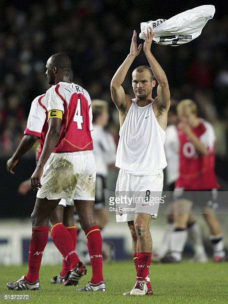 Arsenal goalscorer Freddie Ljungberg applauds the fans after The Champions League Group E game between Rosenborg and Arsenal at the Lerkendal Stadium...