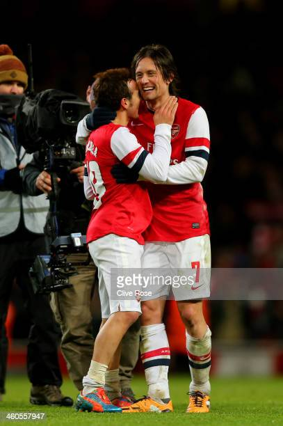 Arsenal goalscorers Santi Cazorla and Tomas Rosicky celebrate their team's 2-0 victory during the Budweiser FA Cup third round match between Arsenal...