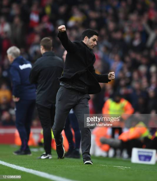 Arsenal Head Coach Mikel Arteta celebrates at the final whistle after the Premier League match between Arsenal FC and West Ham United at Emirates...