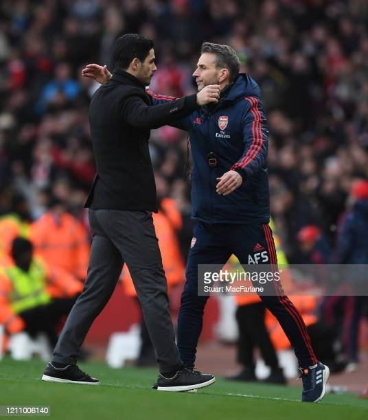 Arsenal Head Coach Mikel Arteta celebrates with assistant Albert Stuivenburg after the Premier League match between Arsenal FC and West Ham United at...