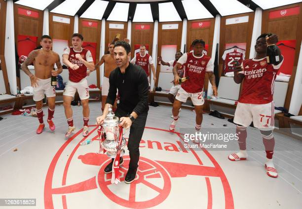 Arsenal Head Coach Mikel Arteta celebrates with Hector Bellerin Kieran Tierney Lucas TOrreira Reiss Nelson and Bukayo Saka after the FA Cup Final...