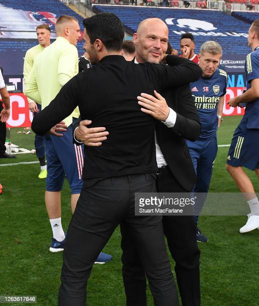 Arsenal Head Coach Mikel Arteta hugs assistant Freddie Ljungberg after the FA Cup Final match between Arsenal and Chelsea at Wembley Stadium on...