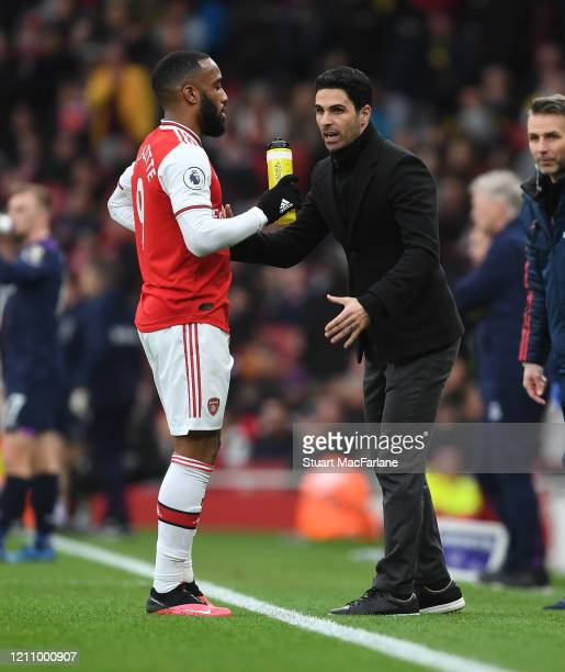 Arsenal Head Coach Mikel Arteta talks to Alex Lacazette during the Premier League match between Arsenal FC and West Ham United at Emirates Stadium on...
