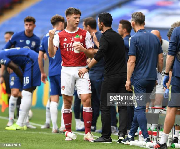 Arsenal Head Coach Mikel Arteta talks to Kieran Tierney during the FA Cup Final match between Arsenal and Chelsea at Wembley Stadium on August 01...