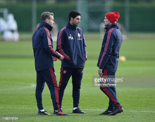 Arsenal Head Coach Mikel Arteta with assistant coaches Albert Stuivenburg and Freddie Ljungberg during a training session at London Colney on...