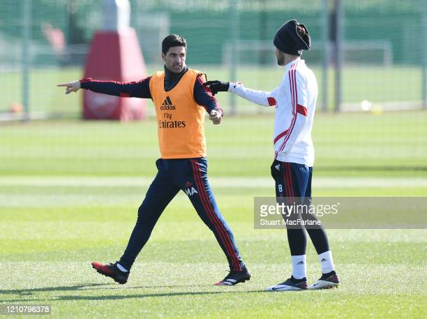 Arsenal Head Coach Mikel Arteta with Dani Ceballos during a training session at London Colney on March 06 2020 in St Albans England