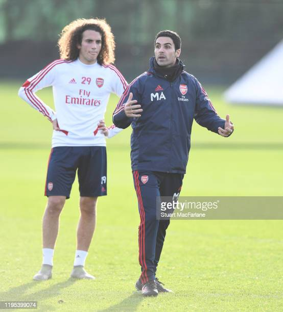 Arsenal Head Coach Mikel Arteta with Matteo Guendouzi during a training session at London Colney on December 22 2019 in St Albans England