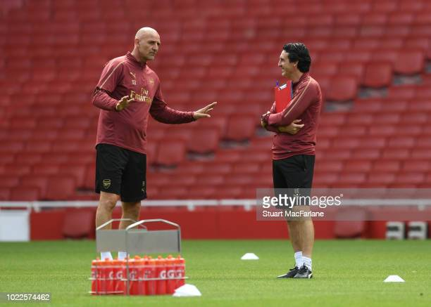 Arsenal Head Coach Unai Emery and Assistant Coach Steve Bould during a training session at Emirates Stadium on August 24 2018 in London England