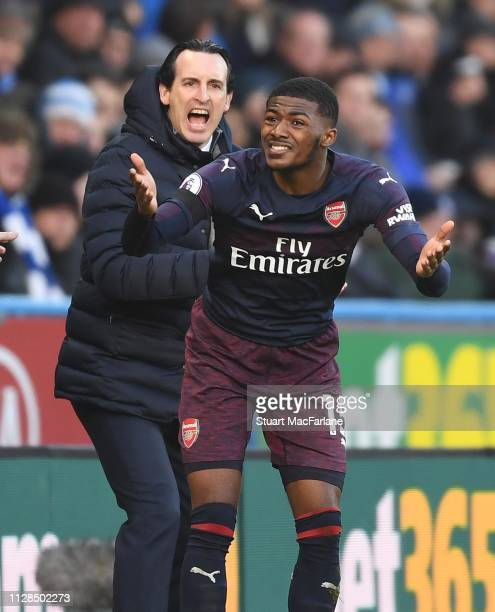 Arsenal Head Coach Unai Emery and defender Ainsley MaitlandNiles complain to the referee during the Premier League match between Huddersfield Town...