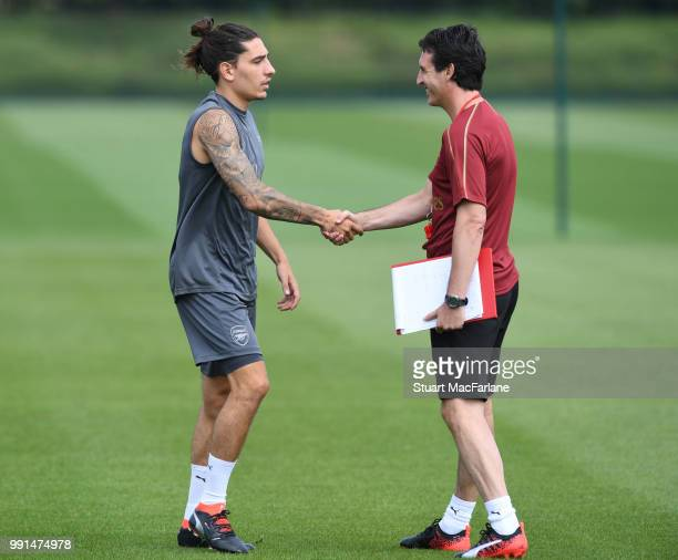Arsenal Head Coach Unai Emery and Hector Bellerin during a training session at London Colney on July 4 2018 in St Albans England