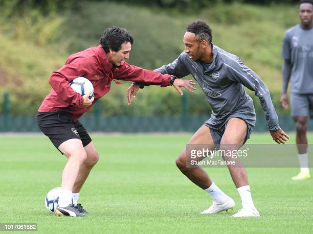 Granit Xhaka and Alex Iwobi of Arsenal during a training session at London Colney on August 15 2018 in St Albans England