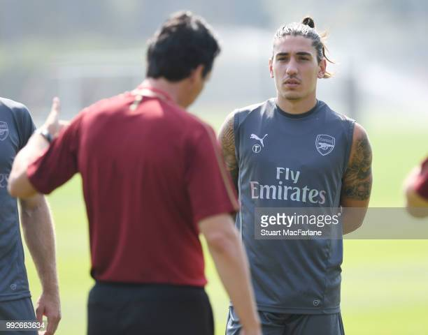 Arsenal Head Coach Unai Emery talkes to Hector Bellerin during a training session at London Colney on July 6 2018 in St Albans England