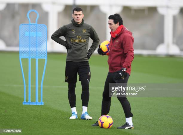 Arsenal Head Coach Unai Emery talks to Granit Xhaka during a training session at London Colney on December 21 2018 in St Albans England