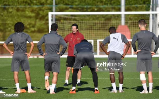 Arsenal Head Coach Unai Emery talks to his playere during a training session at London Colney on September 25 2018 in St Albans England