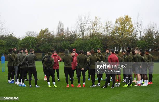 Arsenal Head Coach Unai Emery talks to his players before a training session at London Colney on November 28 2018 in St Albans England