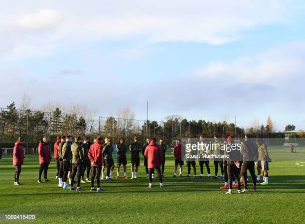 Arsenal Head Coach Unai Emery talks to his team before a training session at London Colney on December 7 2018 in St Albans England