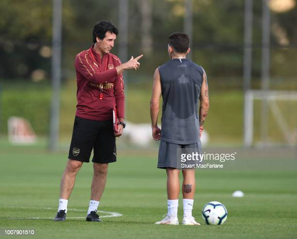 Arsenal Head Coach Unai Emery talks to Lucas Torreira during a training session at London Colney on July 30 2018 in St Albans England