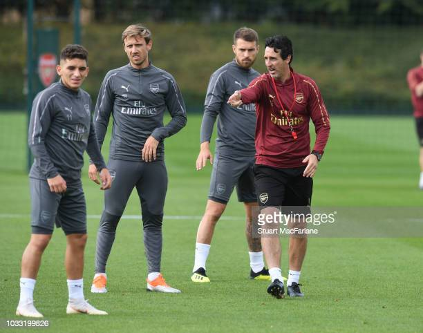 Arsenal Head Coach Unai Emery talks to Lucas Torreira Nacho Monreal and Aaron Ramsey during a training session at London Colney on September 14 2018...