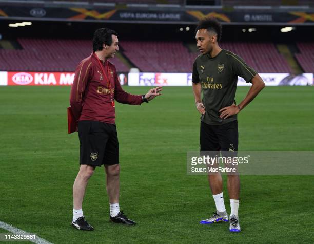 Arsenal Head Coach Unai Emery talks to PierreEmerick Aubameyang during a training session at Stadio San Paolo on April 17 2019 in Naples Italy