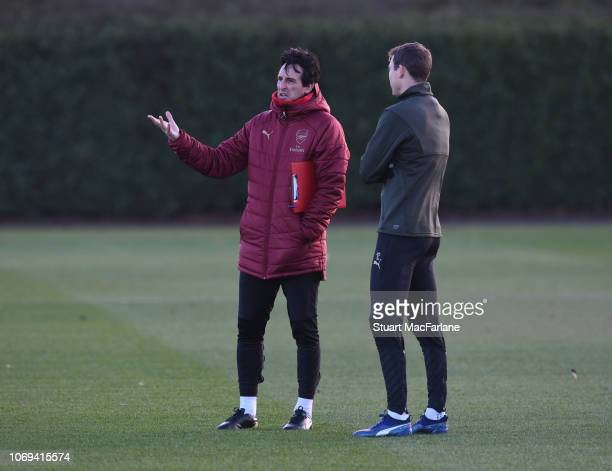 Arsenal Head Coach Unai Emery talks to Stephan Lichtsteiner before a training session at London Colney on December 7 2018 in St Albans England