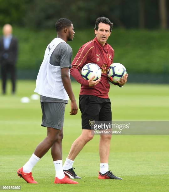 Arsenal Head Coach Unai Emery with Ainsley MaitlandNiles during a training session at London Colney on July 10 2018 in St Albans England
