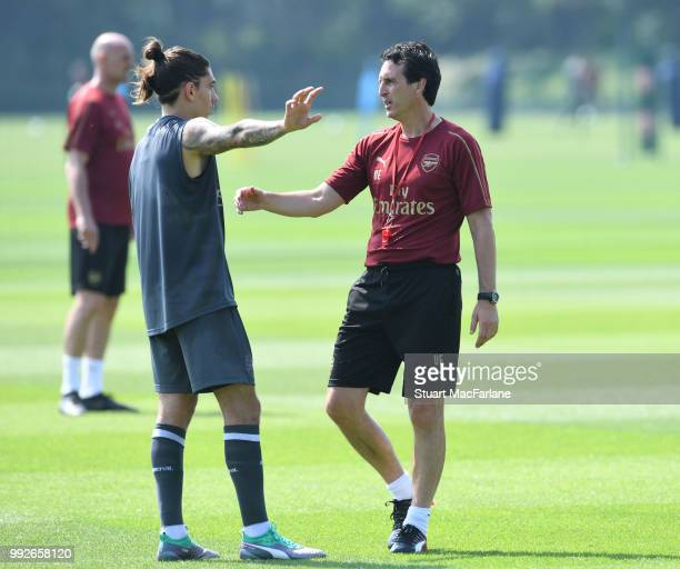 Arsenal Head Coach Unai Emery with Hector Bellerin during a training session at London Colney on July 6 2018 in St Albans England