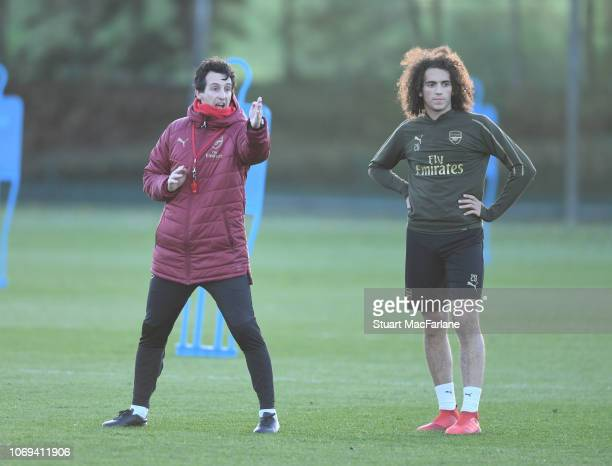 Arsenal Head Coach Unai Emery with Matteo Guendouzi during a training session at London Colney on December 7 2018 in St Albans England