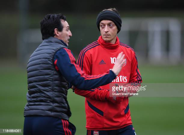Arsenal Head Coach Unai Emery with Mesut Ozil during a training session at London Colney on November 01, 2019 in St Albans, England.