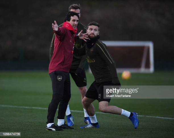 Arsenal Head Coach Unai Emery with Shkodran Mustafi during a training session at London Colney on November 2 2018 in St Albans England