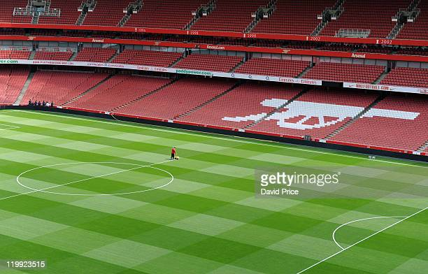 Arsenal Head Groundsman Paul Ashcroft marks out the pitch for the first time ahead of the new season at Emirates Stadium on July 27 2011 in London...