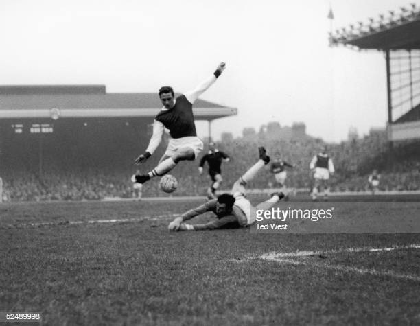 Arsenal inside right John Radford leaps over Leicester City goalkeeper Gordon Banks during a first division match at Highbury London 23rd January 1965