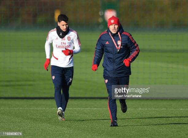 Arsenal Interim Head Coach Freddie Ljungberg with Gabriel Martinelli during a training session at London Colney on December 14 2019 in St Albans...