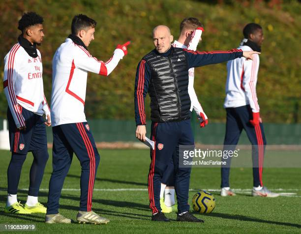 Arsenal Interim Head Coach Freddie Ljungberg with Mesut Ozil during a training session at London Colney on November 29 2019 in St Albans England