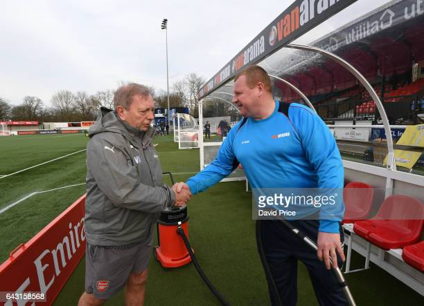 Arsenal Kitman Vic Akers meets Wayne Shaw of Sutton before the match between Sutton United and Arsenal on February 20 2017 in Sutton Greater London